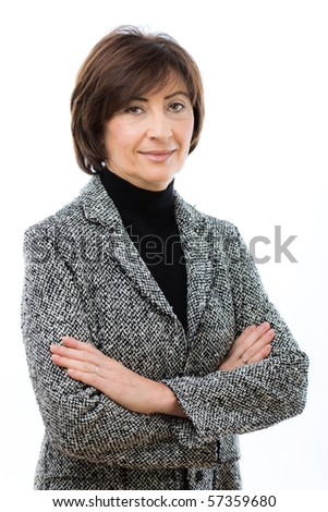Senior businesswoman wearing grey suit standing with crossed arms, smiling. Isolated on white background. - stock photo