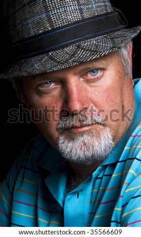 Senior caucasian man with hat on - stock photo
