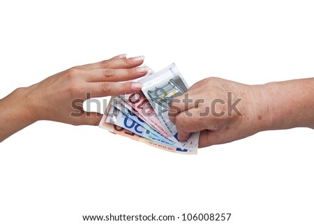 Senior citizen gives a young woman a lot of money - stock photo