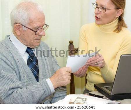Senior client and woman agent holding an agreement togetherness - stock photo