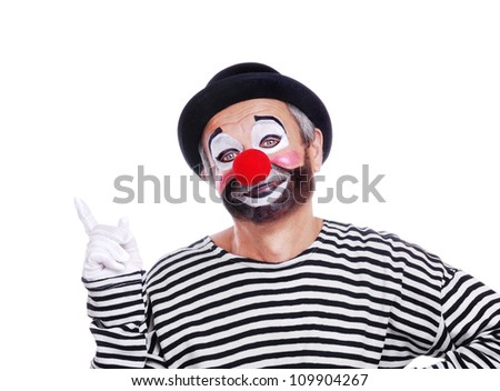 Senior clown in bowler hat pointing to the copy space area - stock photo