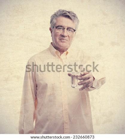 senior cool man offering water - stock photo