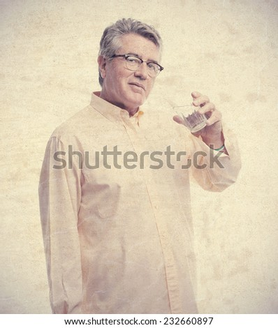 senior cool man with glass of water - stock photo