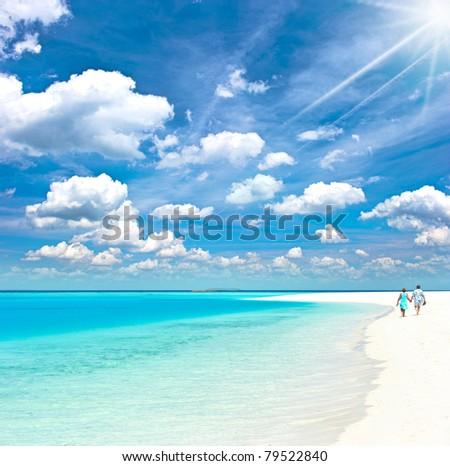 senior couple at the tropical beach - stock photo