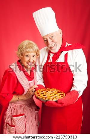 Senior couple baked a cherry pie together.   - stock photo