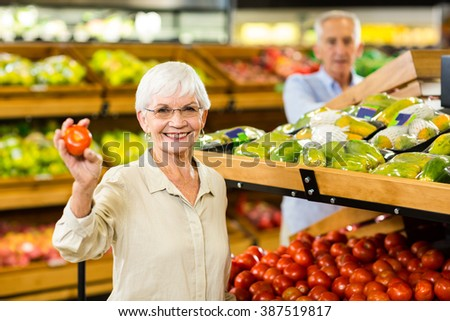 Senior couple buying food at the grocery shop - stock photo