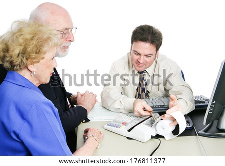 Senior couple consulting an accountant to help with taxes and financial planning.  White background - stock photo