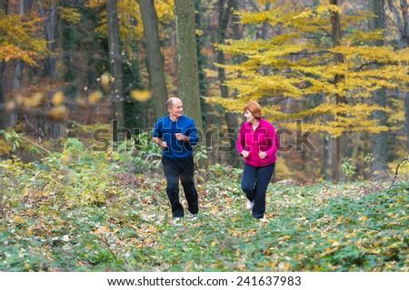 Senior Couple doing sport outdoors - stock photo