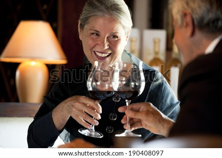 Senior couple drinking wine at the restaurant - stock photo