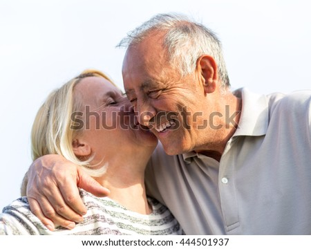 Senior couple embracing each other. - stock photo