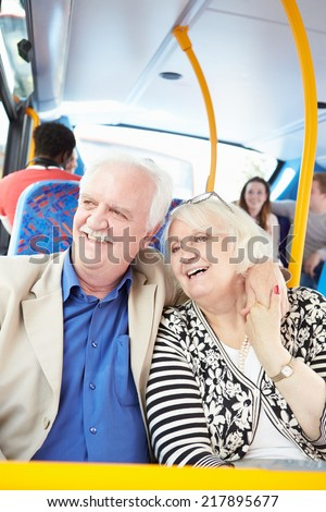 Senior Couple Enjoying Journey On Bus - stock photo