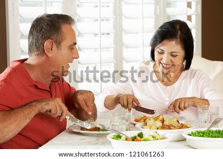 Senior Couple Enjoying Meal At Home - stock photo