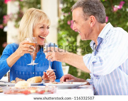 Senior Couple Enjoying Meal outdoorss - stock photo
