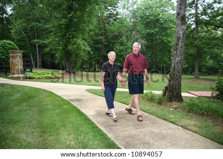 Senior couple enjoying the outdoors - stock photo