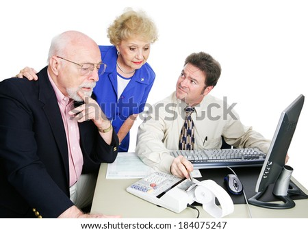 Senior couple getting financial advice from their accountant.  White background.   - stock photo