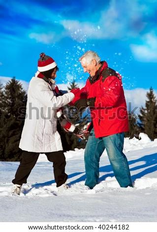 senior-couple having fun in wintertime - stock photo
