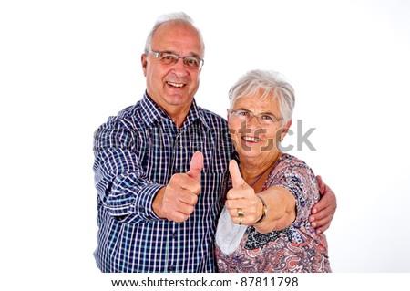 senior couple holding her thumb up - stock photo