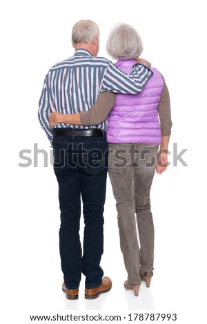 Senior couple in front of white background - stock photo