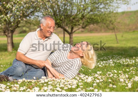 Senior couple in love enjoying togetherness outdoor. - stock photo