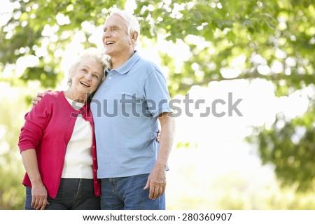 Senior couple in park - stock photo
