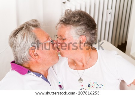 senior couple kissing - stock photo