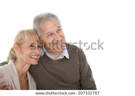 Senior couple looking on one side, being happy - stock photo