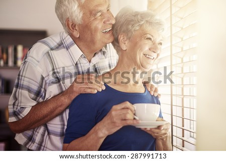 Senior couple next to the window