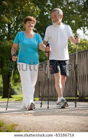 Senior couple Nordic walking - stock photo