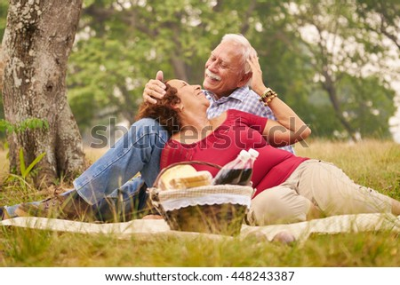 Senior couple, old man and woman in park on weekend activity. Grandpa and grandma doing picnic in wood. Concept of retirement age and love. - stock photo