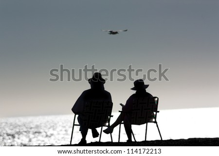 Senior Couple Relaxing at Point Dume State Beach in Malibu, California - stock photo