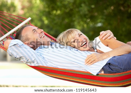 Senior Couple Relaxing In Hammock - stock photo
