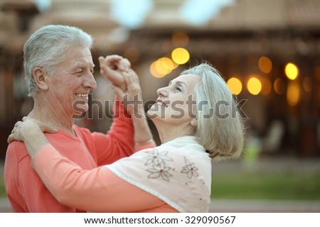 Senior couple resting at the resort during vacation on dance floor - stock photo