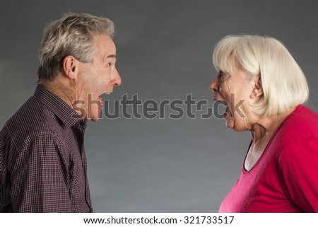 Senior couple, shouting at each other - stock photo