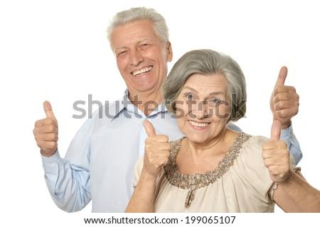 Senior couple showing ok thumbs up isolated on white background - stock photo