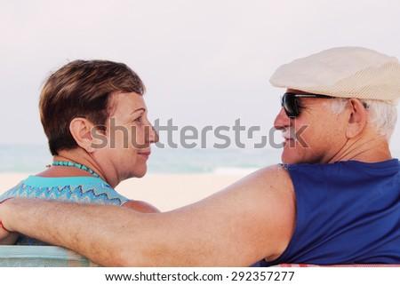 Senior Couple Sitting On the Beach - stock photo