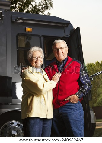 Senior Couple Standing by Motor Home - stock photo