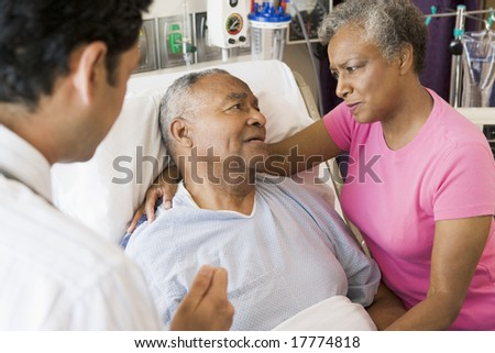 Senior Couple Talking To Doctor,Looking Worried - stock photo