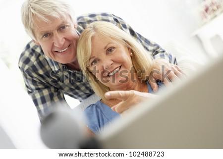 Senior couple using skype - stock photo