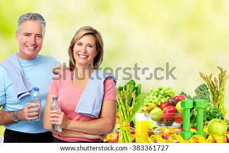 Senior couple with bottle of water. - stock photo