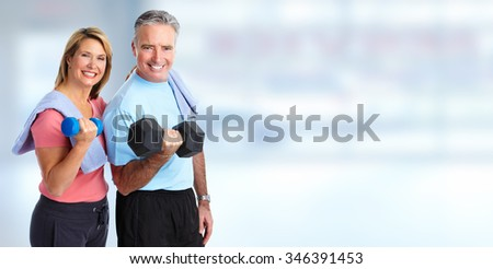 Senior couple with dumbbell. Healthy lifestyle background. - stock photo