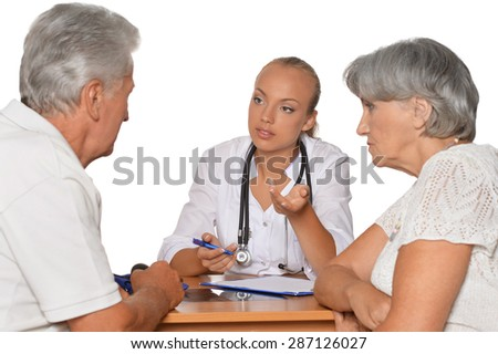 Senior Couple with thumbs up and young doctor at hospital on white background - stock photo