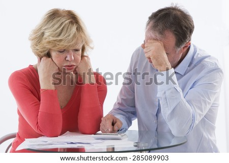 Senior couple  worried about paying bills and bankruptcy - stock photo