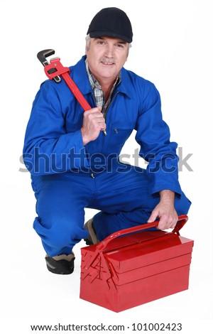 senior craftsman holding a spanner - stock photo