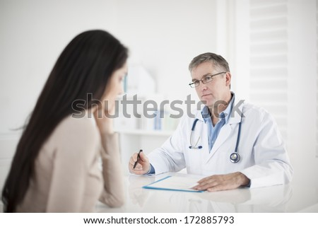 senior  doctor consulting female patient - stock photo