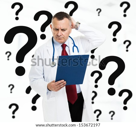 Senior doctor in trouble - stock photo