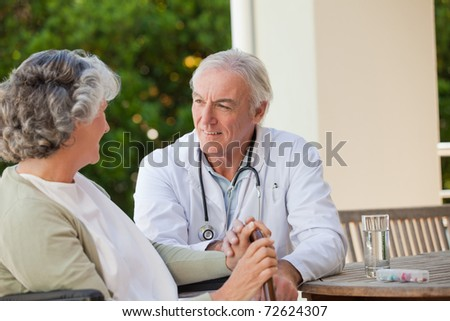 Senior doctor talking with his mature patient - stock photo