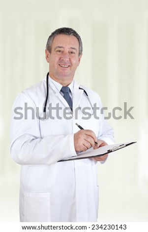 Senior doctor with clipboard - stock photo