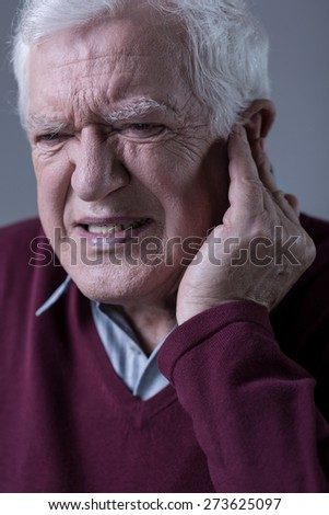 Senior elegant man with sharp earache - stock photo