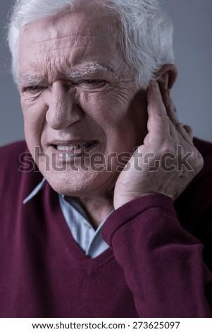 Senior elegant man with sharp earache - stock photo