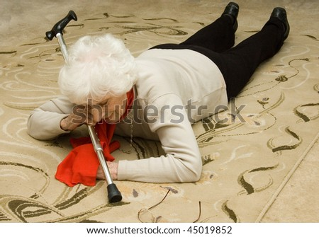 senior falls, unable to get up - stock photo